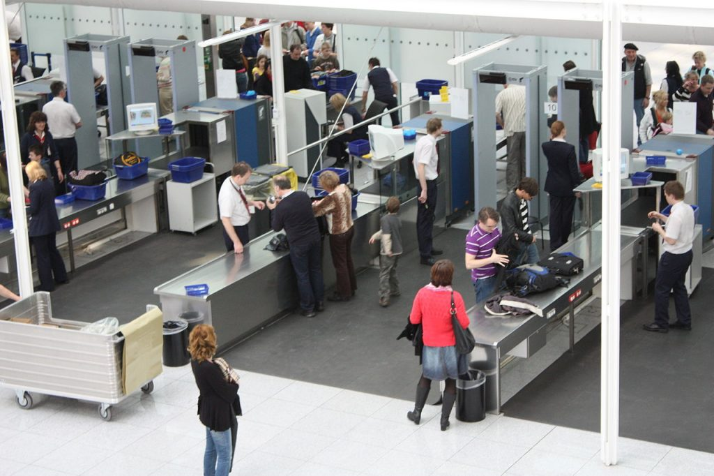 Going through travel security checks in airport