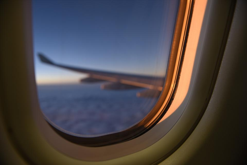 View from plane window as sun sets
