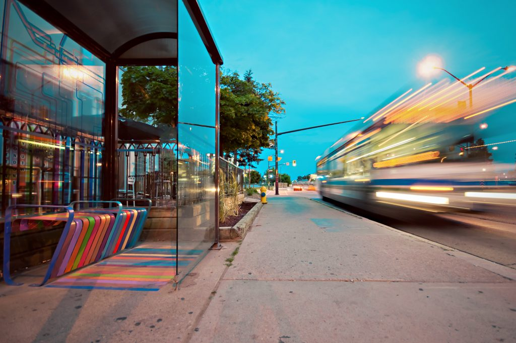 Bus travelling past bus stop with GPS for coach security