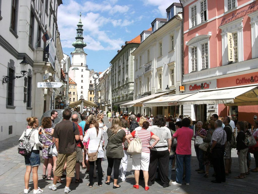 Tourists queueing up outside a shop in Bratislava
