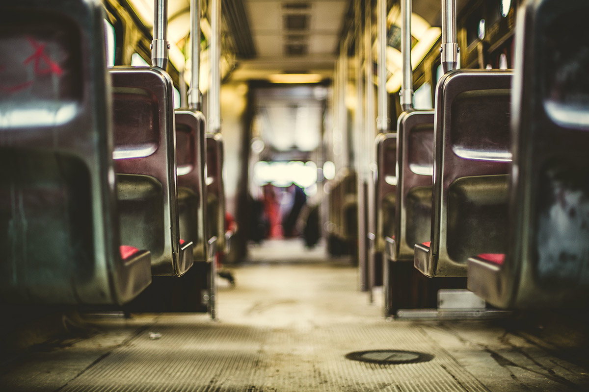 Looking down bus aisle in need of new transport technology