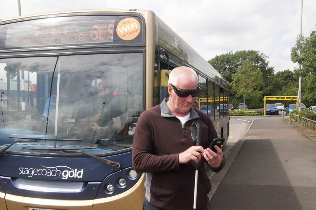Man relying on an app to navigate public transport