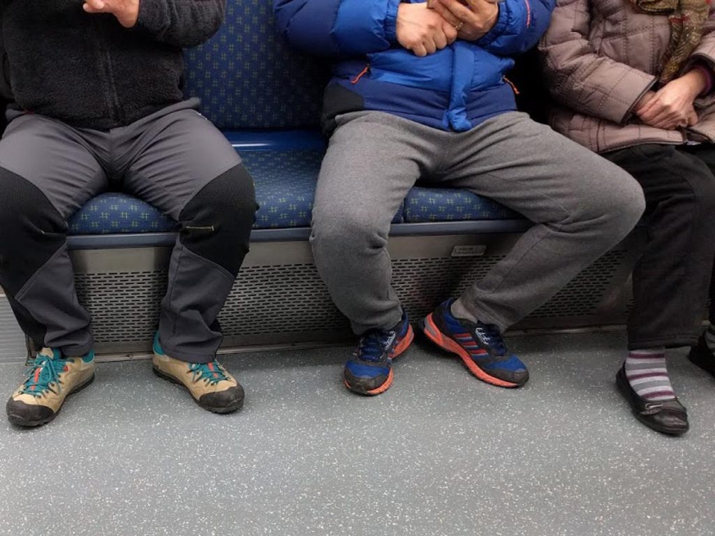 Manspreading passenger on public transport