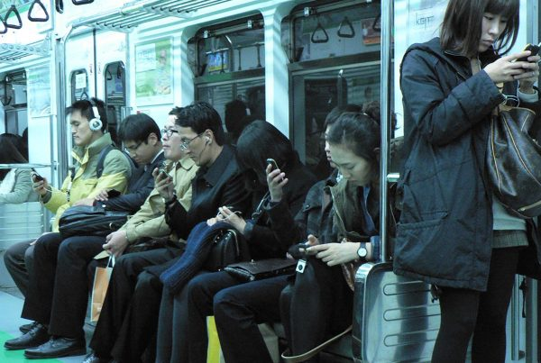 Passengers on their smartphones