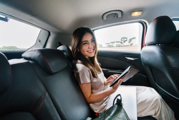 Woman smiling using in taxi WiFi