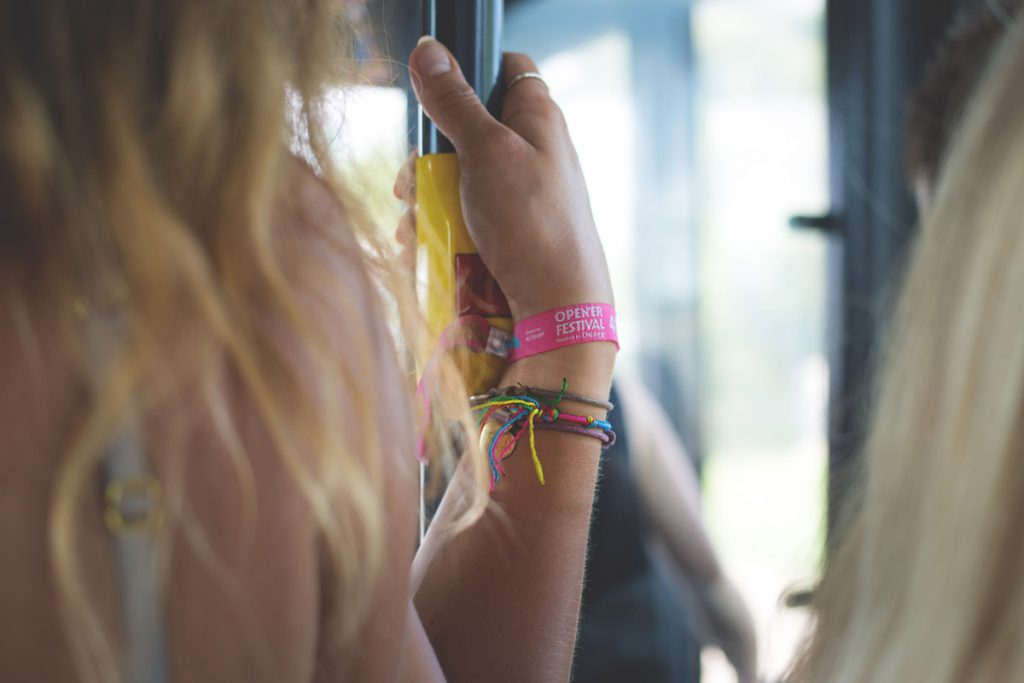 Girl using festival coach hire to attend event
