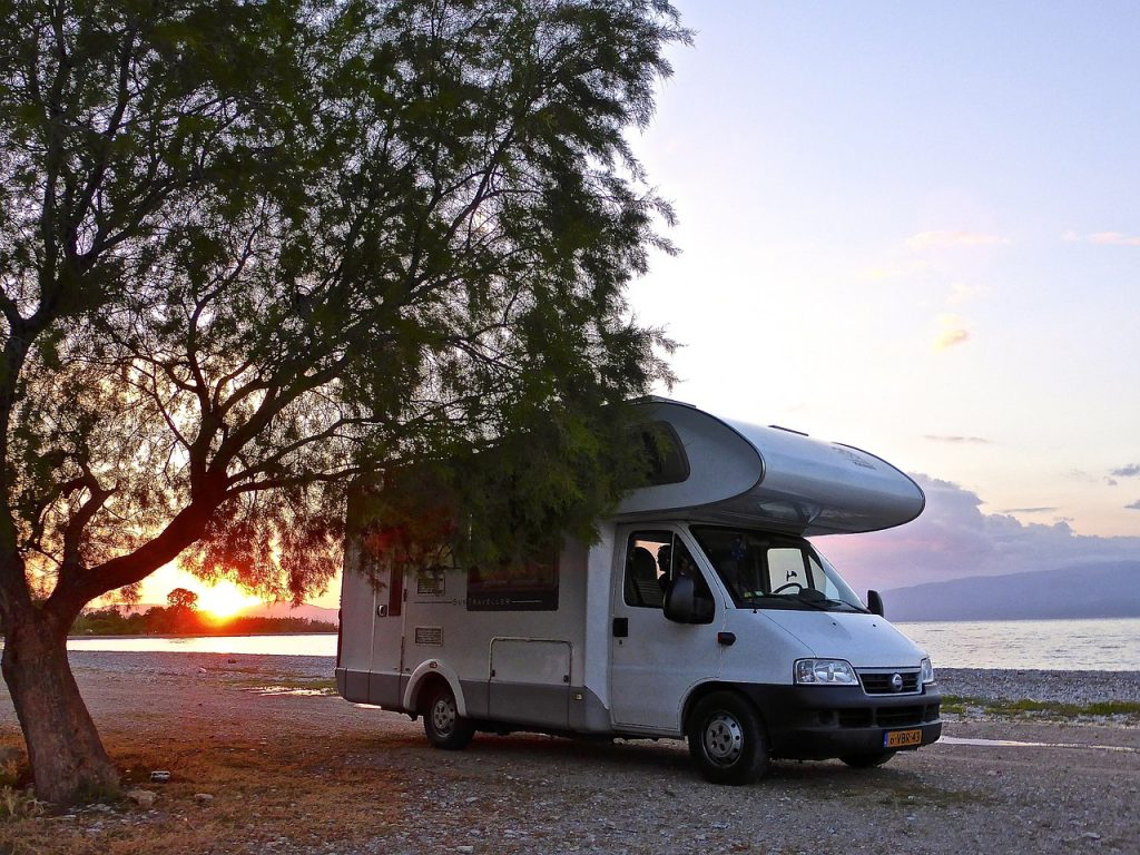 Caravan parked on beach using motorhome WiFi