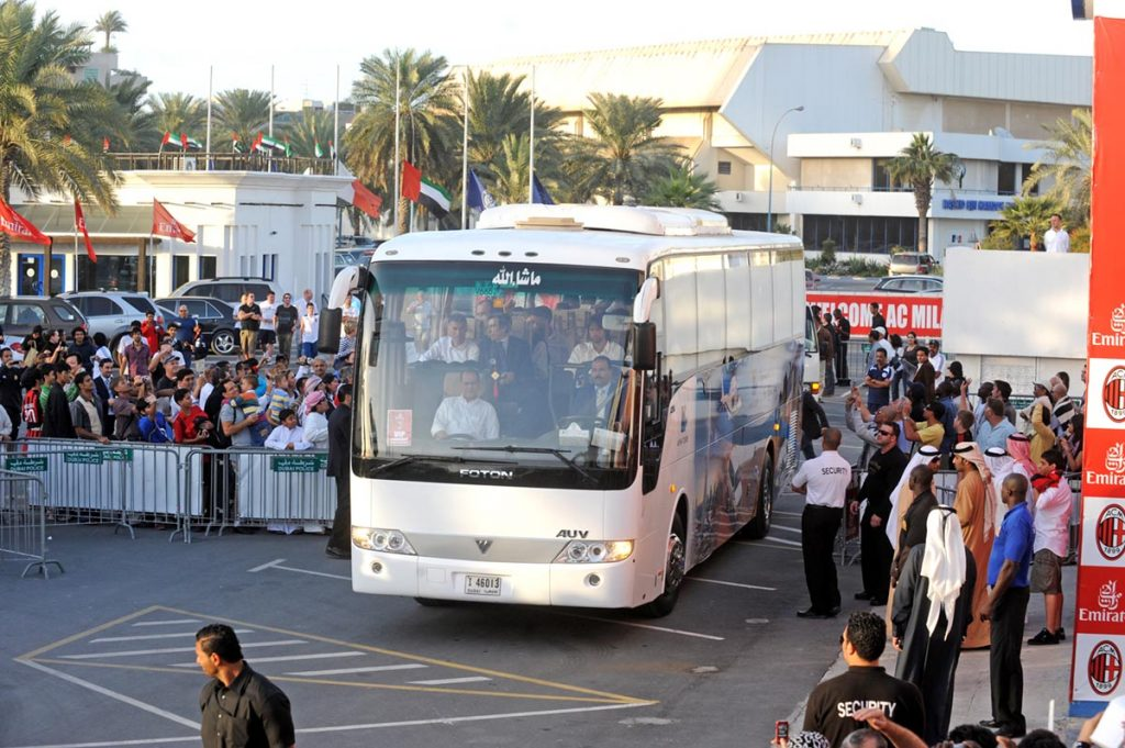 Coach travel for sports events bus pulling into stadium