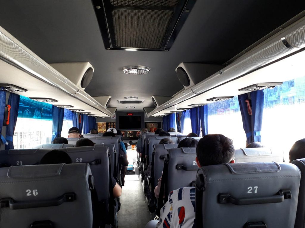 Passengers sat on bus using coach travel for sports events